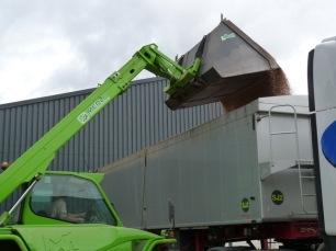 the wheat is loaded onto lorries to be taken to the co-operative grain store