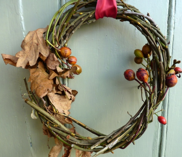 christmas wreath with rosehips