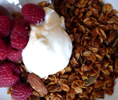 eating raspberry granola