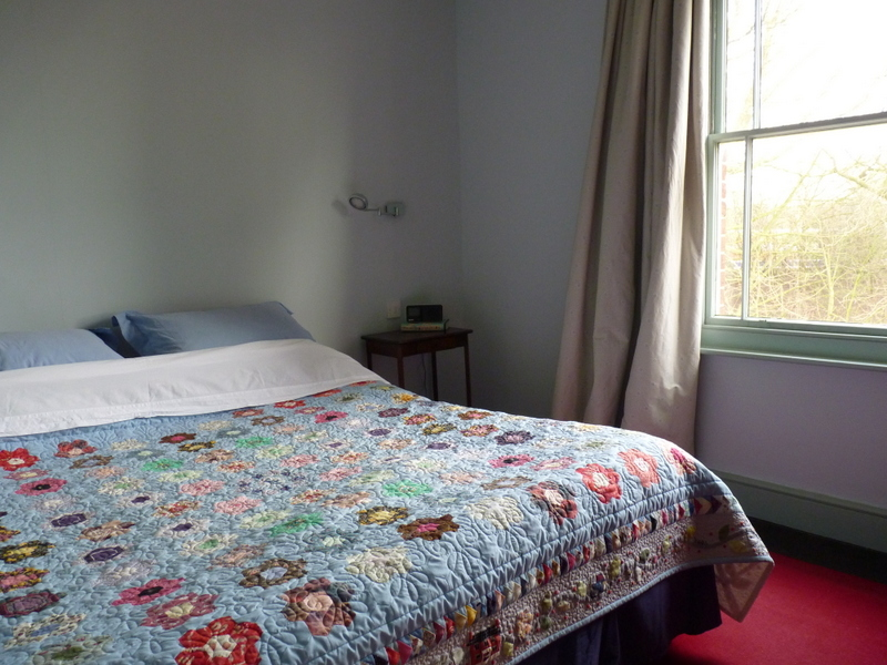 bed with patchwork quilt