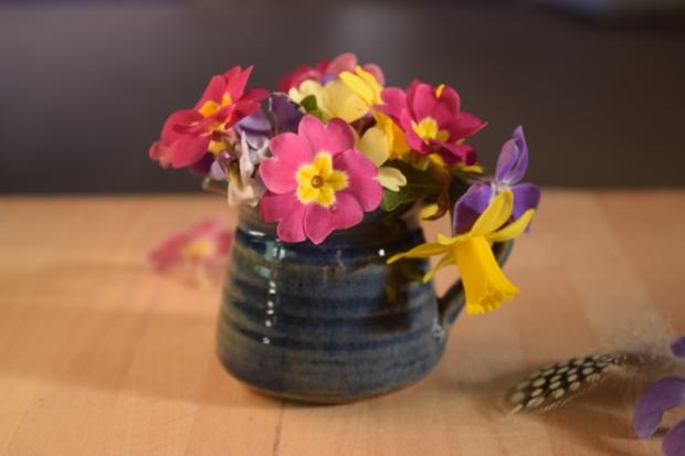 spring flowers in a jug