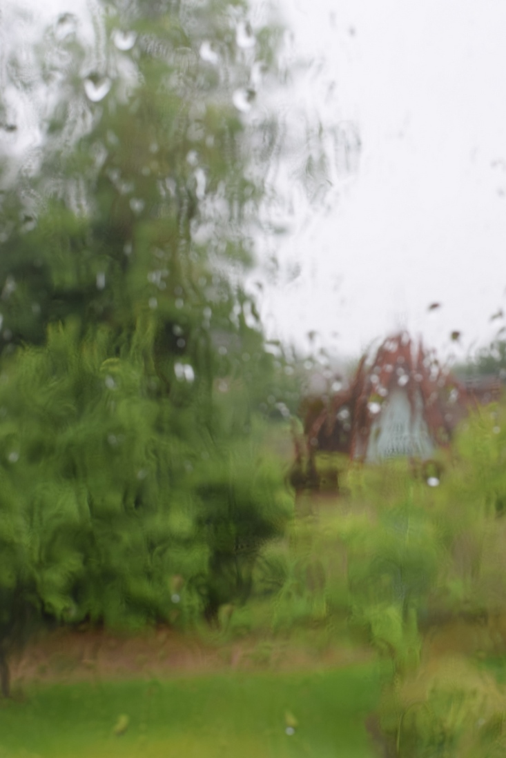 first day of summer rain on the window