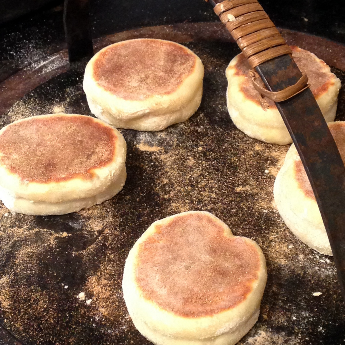 English muffins baking on girdle
