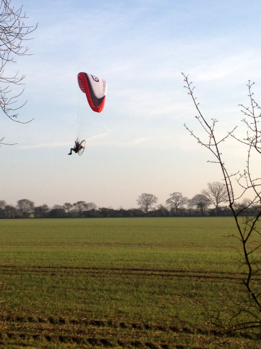 paramotor flying above Great Notley