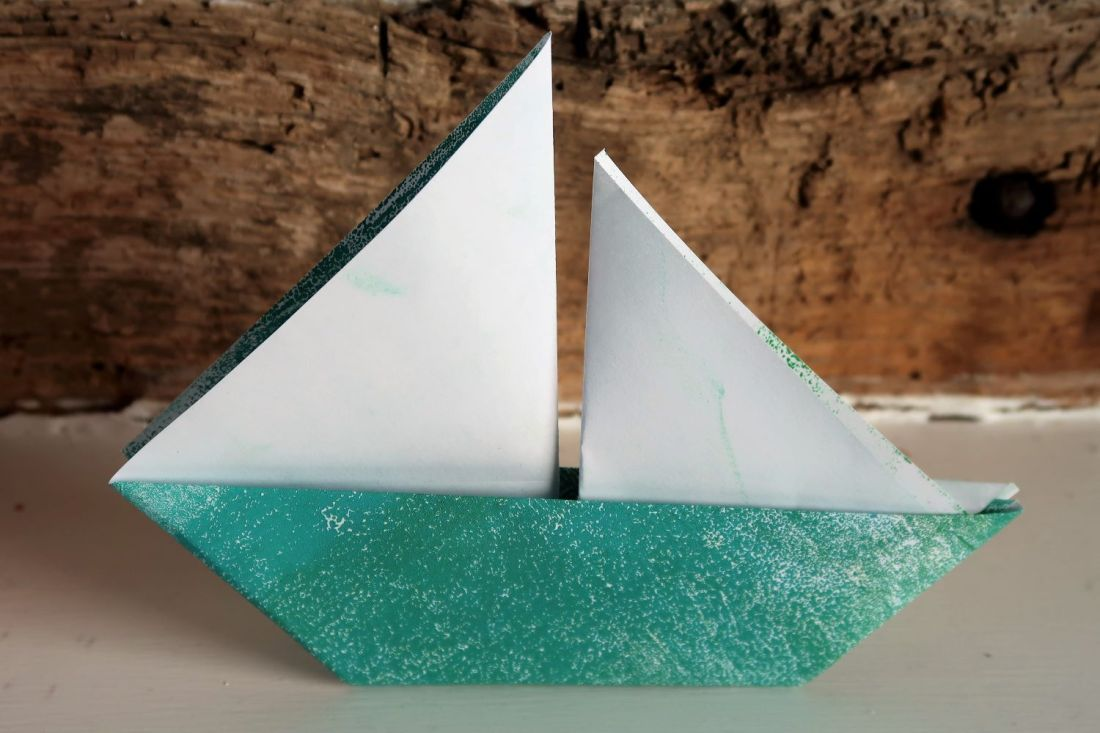 Paper boat made from old print