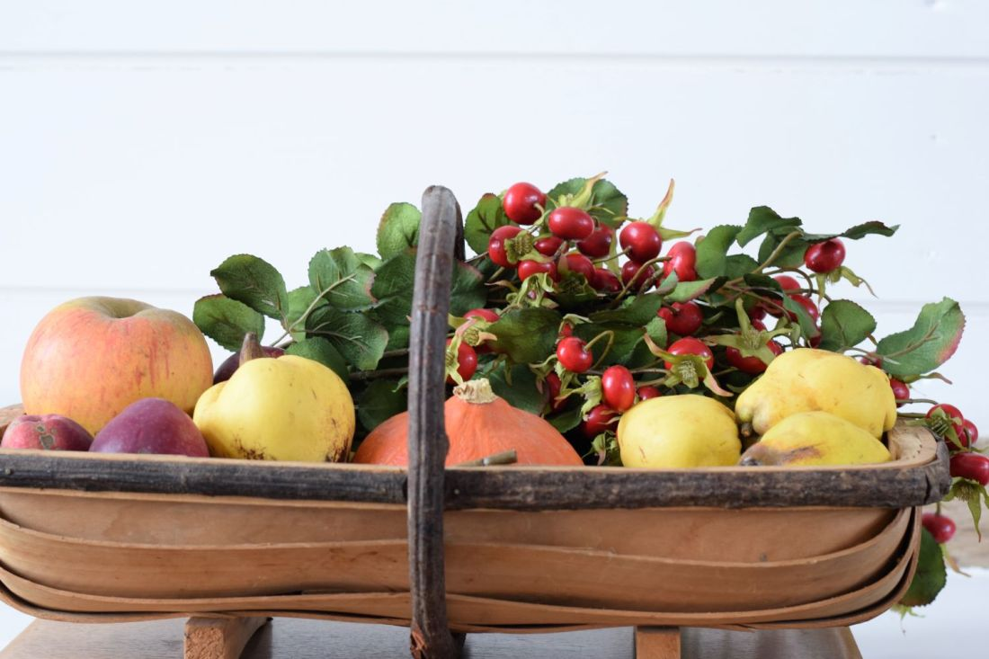 trug filled with autumn fruit