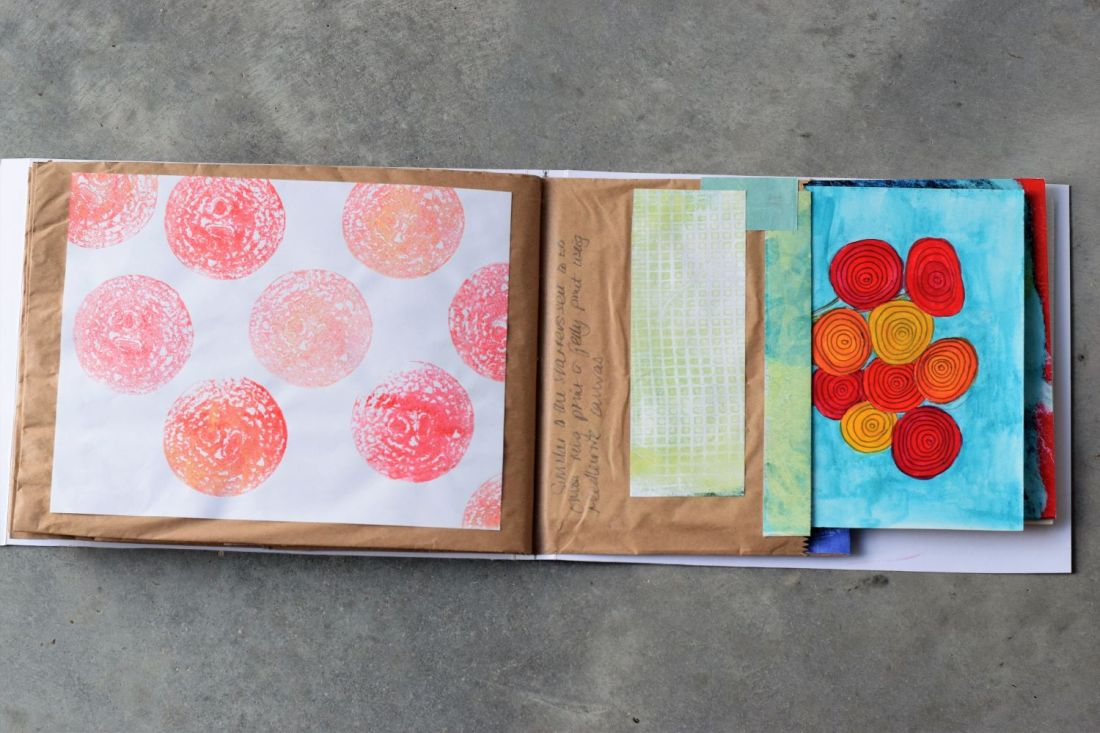 Paper bag book as part of the Letterbox Art Collaboration project. onion ring prints and flower print